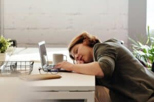 A woman asleep at her desk